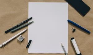 Blank sheet with writing utensils around it-521135-edited