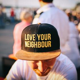 Man wearing love your neighbour hat-108916-edited