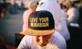 Man wearing love your neighbour hat-964767-edited
