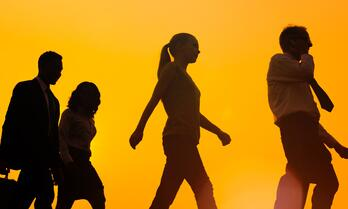 People walking orange background-604000-edited
