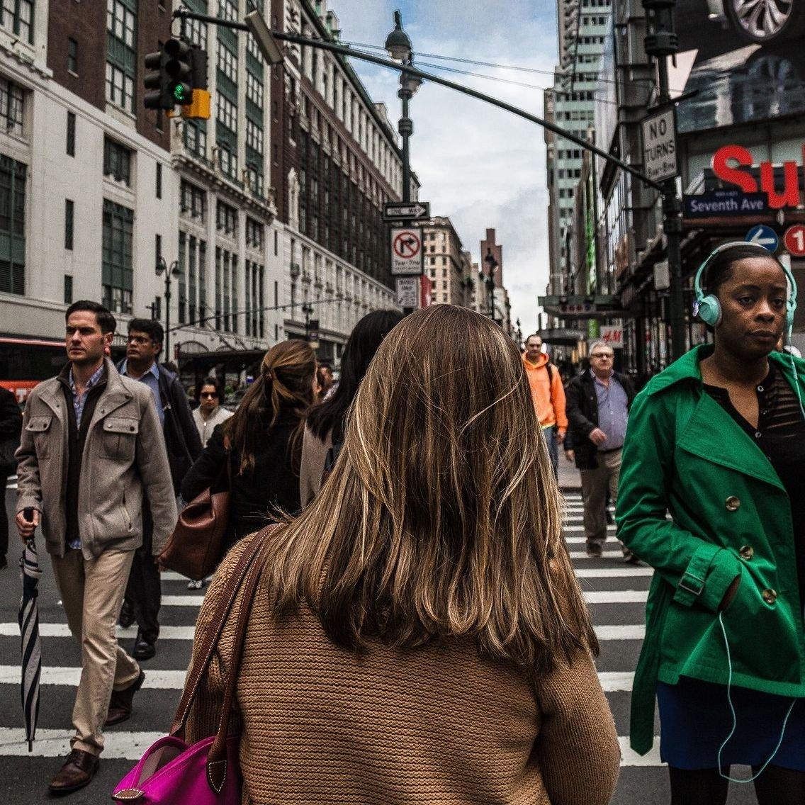 Woman Walking on Street Square