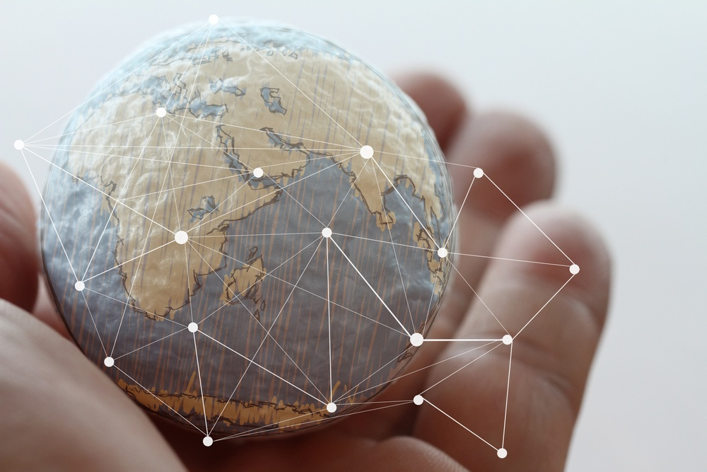 close up of businessman hand showing texture the world with digital social media network diagram concept Elements of this image furnished by NASA.jpeg