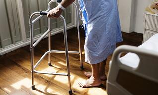 patient in hospital using walker-836272-edited