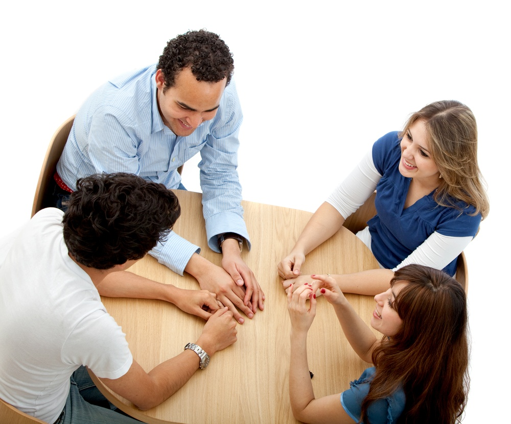 Group of people in a round table isolated over a white background.jpeg