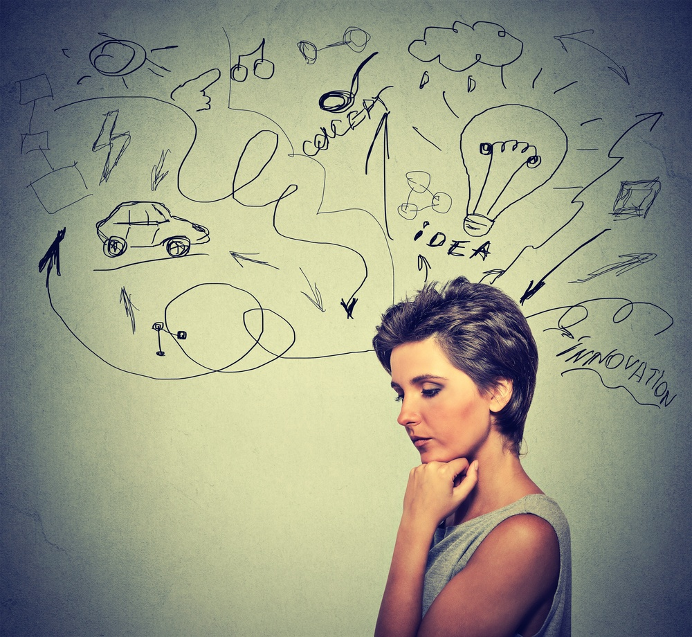 Portrait worried young woman thinking dreaming has many ideas looking down isolated grey wall background. Human emotions feelings life perception. Decision making process concept..jpeg