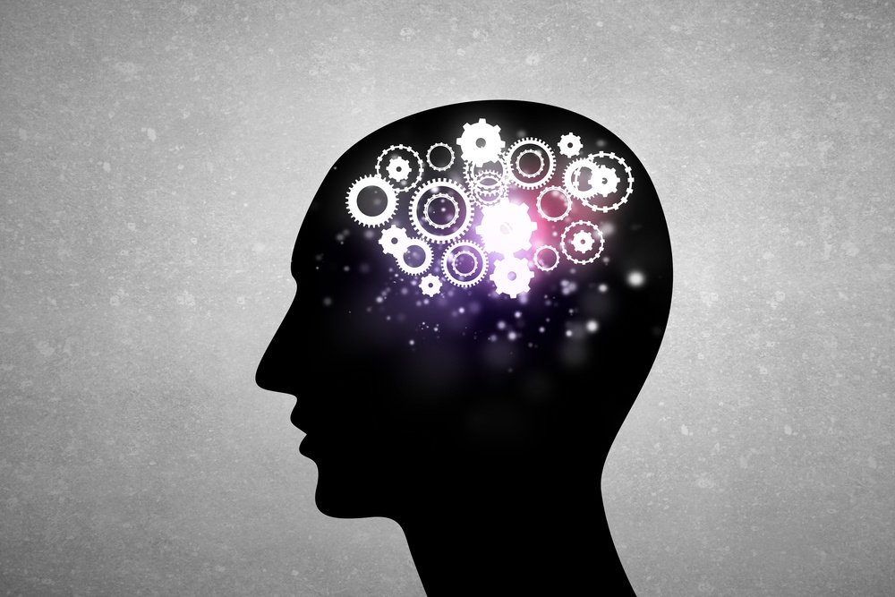 Silhouette of human head with gears instead of brain.jpeg