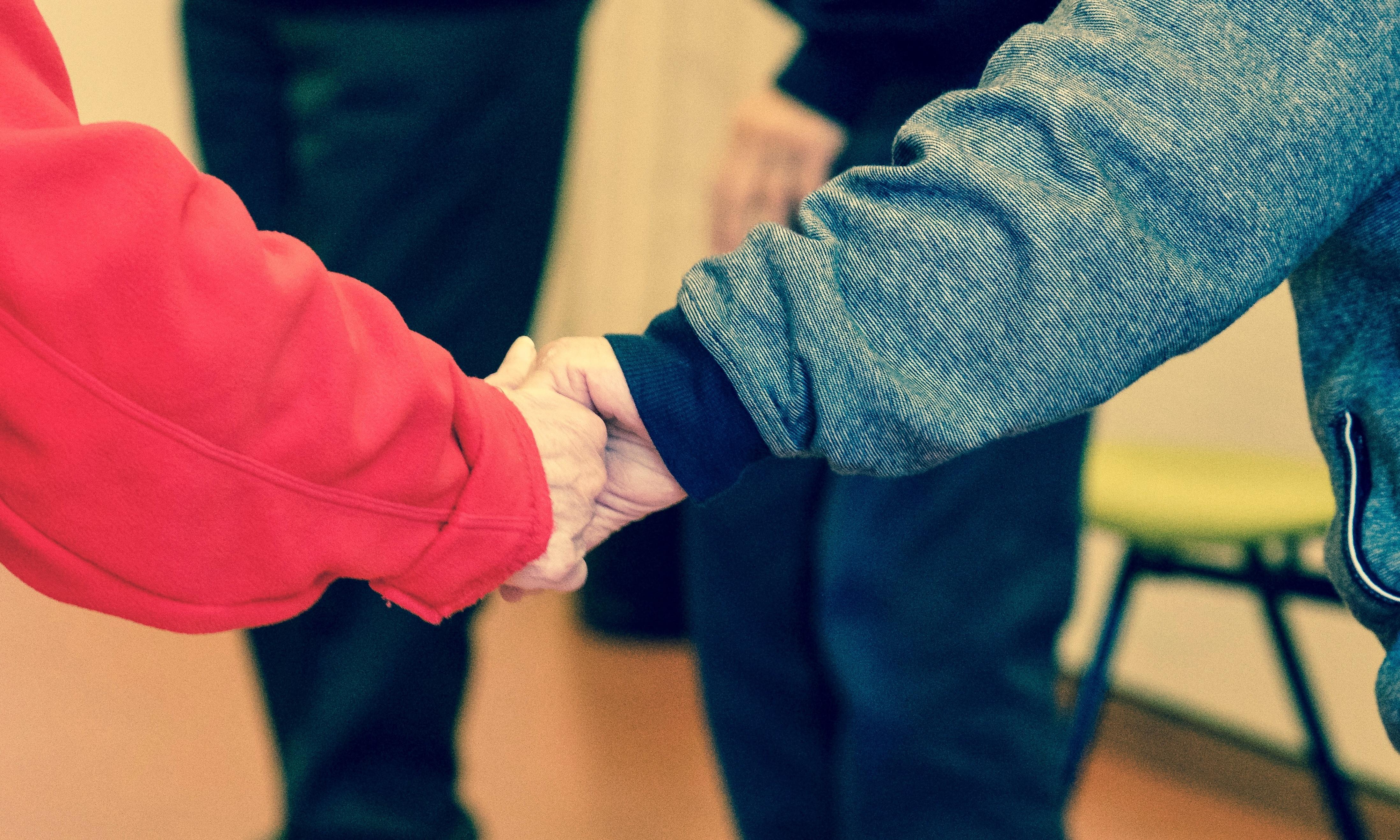 hand holding together friendship bond
