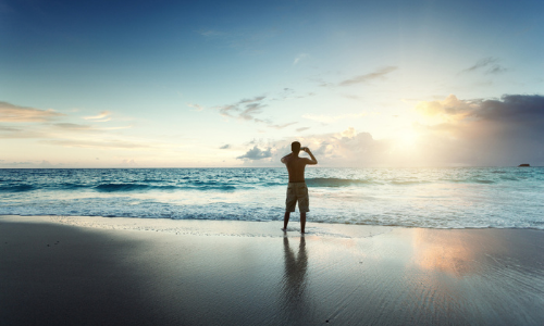man taking picture on beach