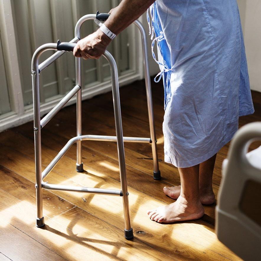 patient in hospital using walker square crop.jpg