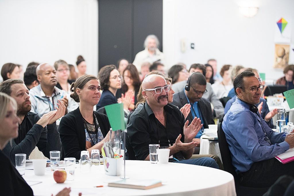 workshop participants clapping