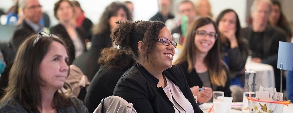 Workshop participants listening